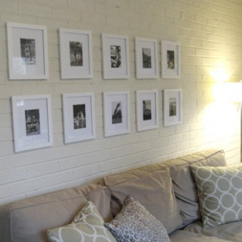 Hanging A Grid Of Family Photos Over The Couch