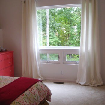 How To Hang Curtains High & Wide (The Window Looks Bigger)