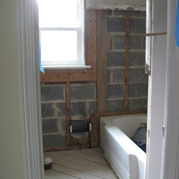 Demoing Tile, Mortar, & Metal Mesh In The Bathroom Walls