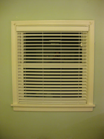 Hanging Some White Faux Wood Blinds In The Bedroom