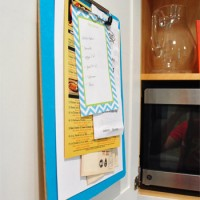 Hanging A Clipboard In A Cabinet To Organize Takeout Menus