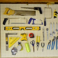 Organizing Tools With A Pegboard & Nails With Glass Jars