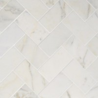 Fireplace Makeover: Tiling The Mantel With Marble Herringbone