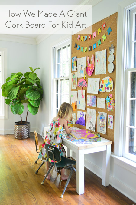 how we made a giant cork board wall for displaying kid art
