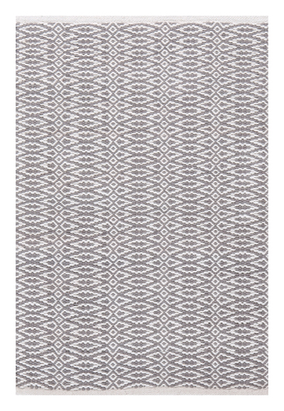 We have a similar gray patterned flatweave rug in our son's room and it hides crumbs and spills like a champ.