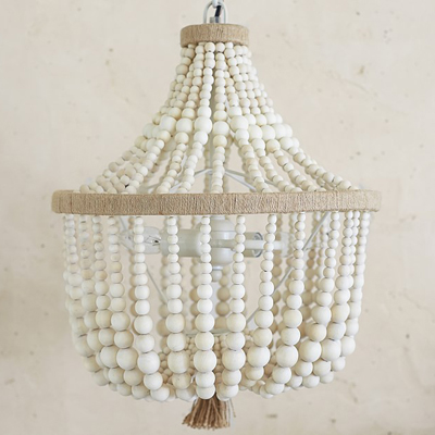 White wooden beads + twine = such a sweet light for an eating nook, entryway, or nursery.