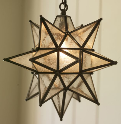 This is like the seeded glass star pendant that we have in our foyer (we love the glow it gives off at night).