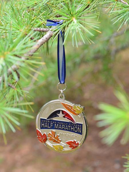 half marathon running race medal hung on christmas tree