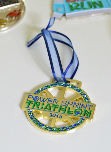 triathlon race medal with shorter ribbon to be hung on christmas tree