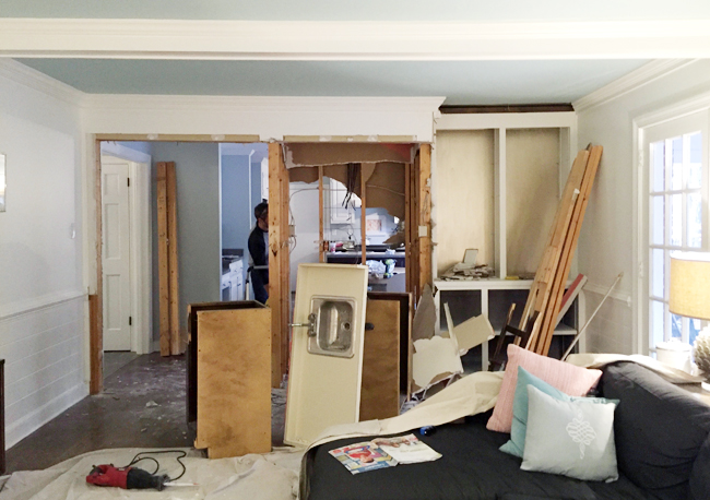 kitchen-demo-wall-coming-down-fireplace