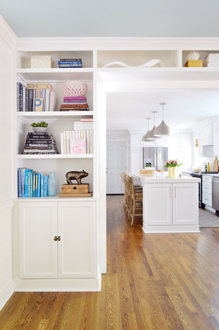 built-in bookshelves in opening to kitchen