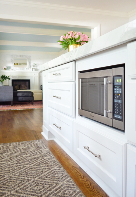 white-kitchen-remodel-final-microwave-with-living-room