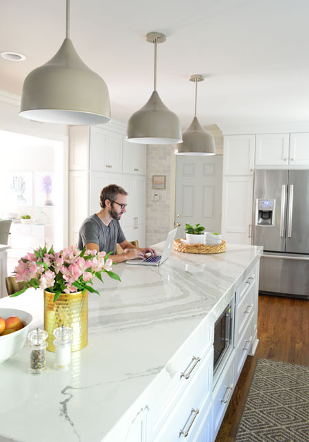white-kitchen-remodel-john-working-at-island