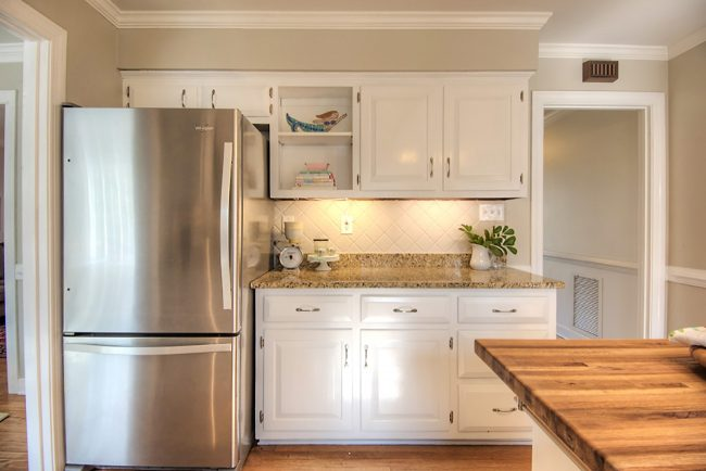 painted kitchen cabinets and clean stainless steel refrigerator