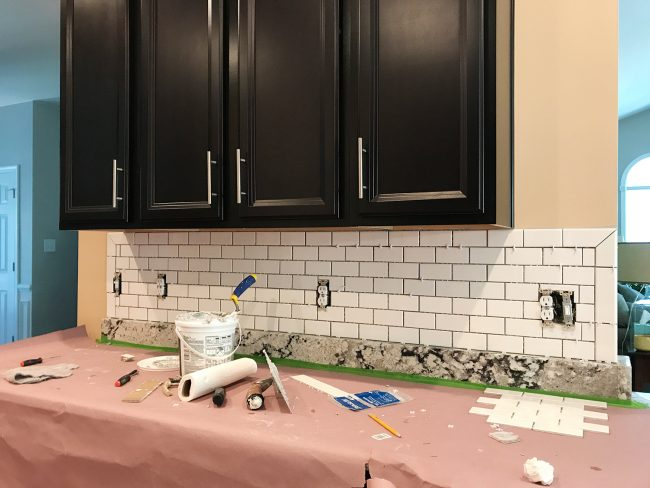 Ungrouted White Subway Tile Backsplash With Bullnose Edges