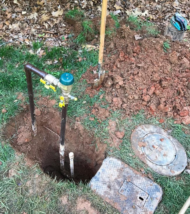irrigation system backflow preventer with blowout dug up