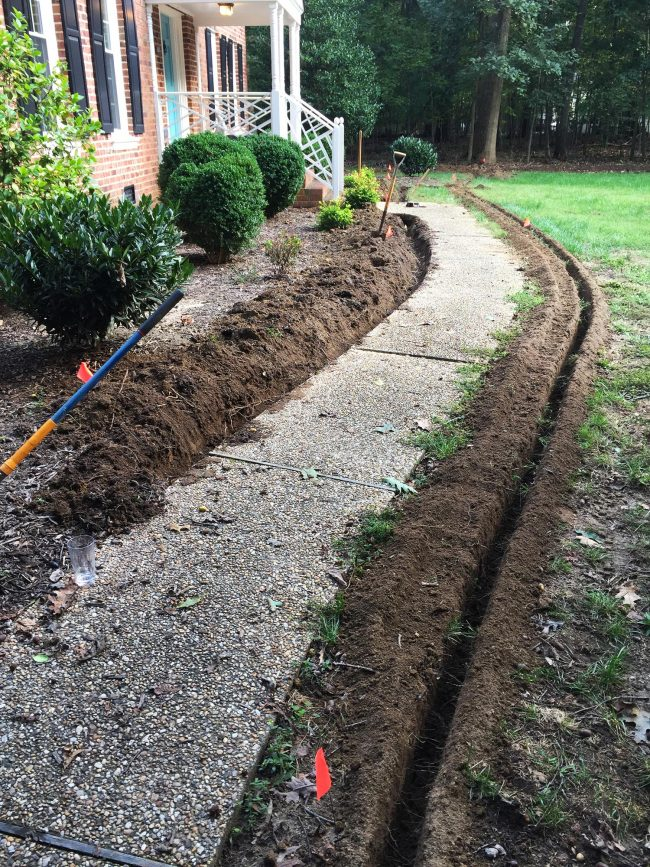 install irrigation system trenches along pathway