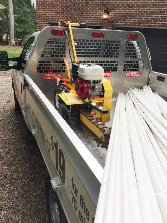 home depot truck with PVC pipe and trencher in back