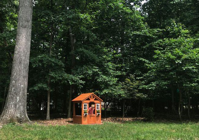 backyard discoveries cedar wooden playhouse in yard