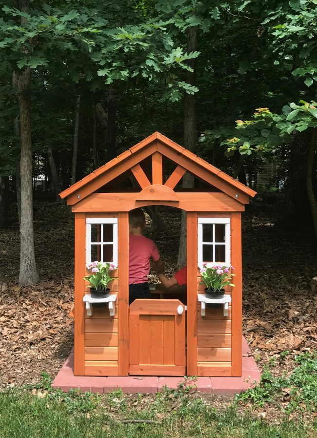 backyard discoveries cedar wooden playhouse kids playing inside