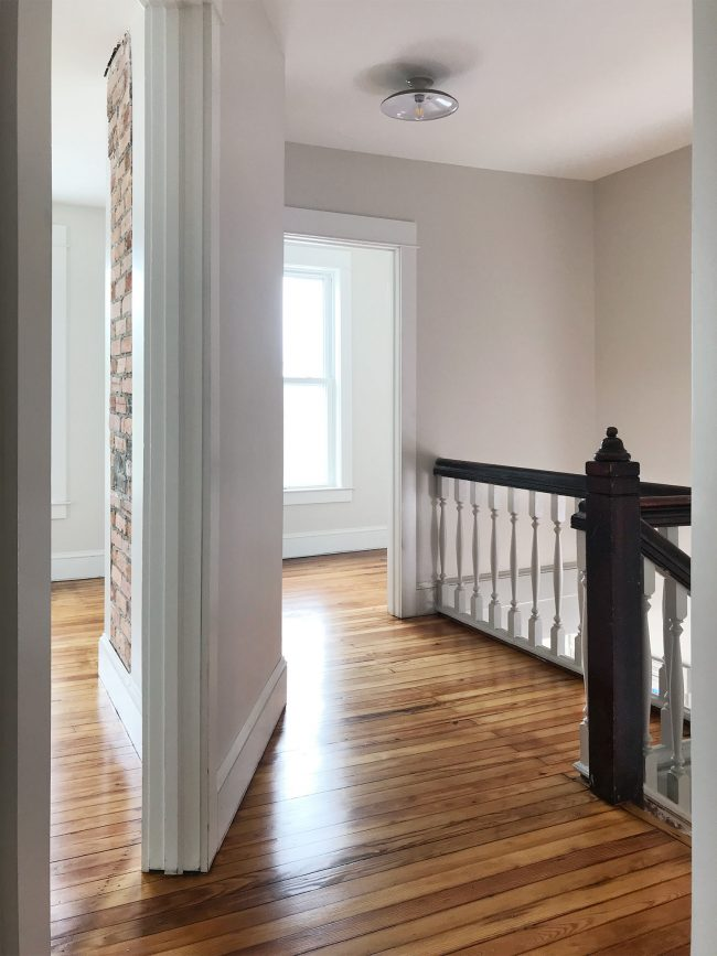 upstairs landing in beach house with refinished pine floors