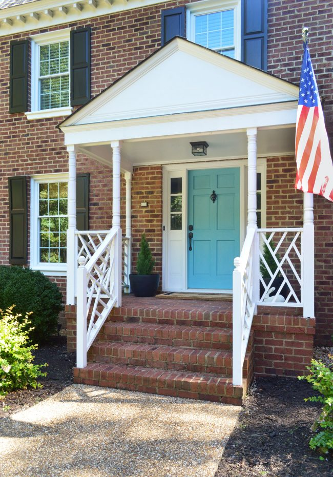Front Porch With Teal Blue Door Fake Plants