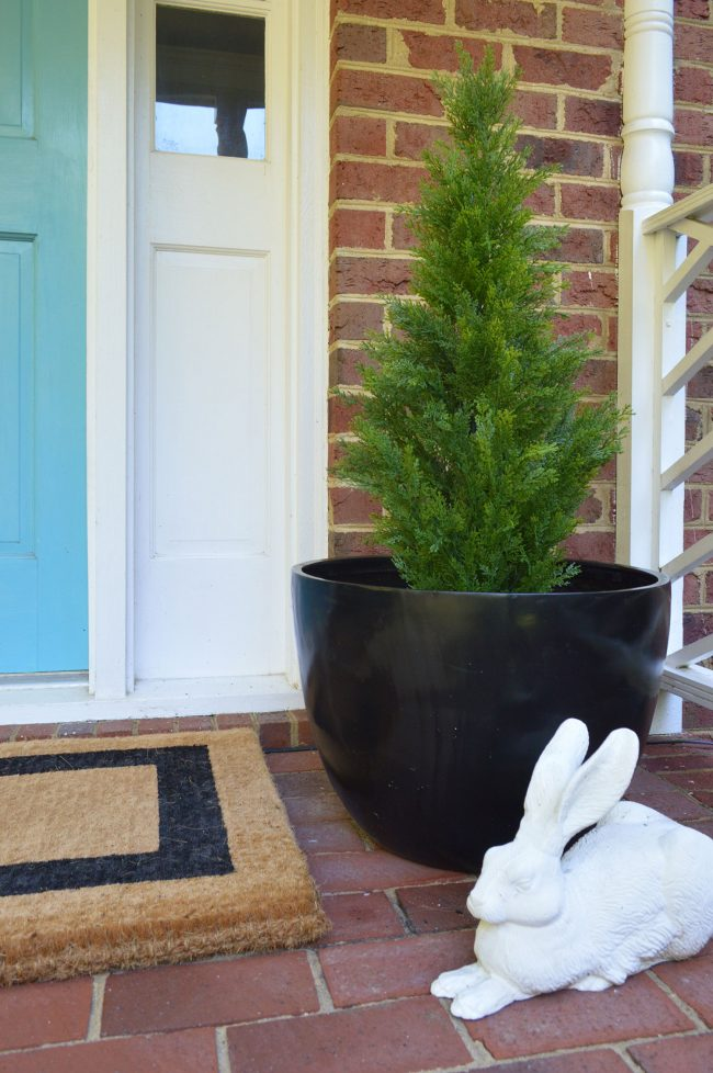 Fake Plant Evergreen In Black Planter On Front Porch