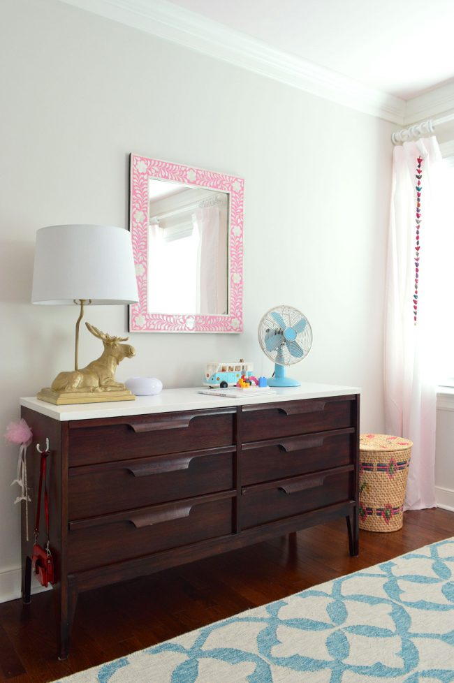 girls bedroom midcentury dresser pink mirror