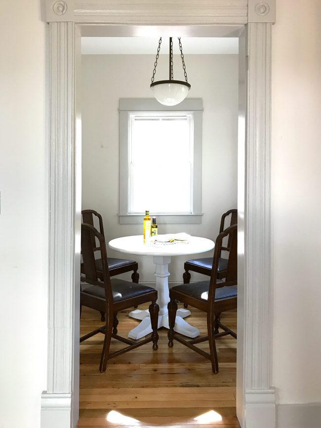 small breakfast nook with chairs before converting to pantry