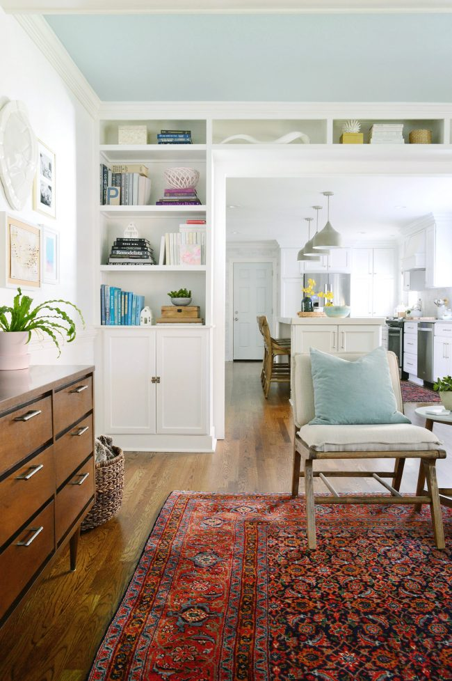 white built-in bookshelves around a doorway in living room