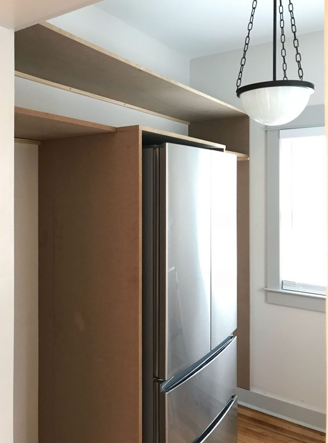 two long horizontal pantry shelves added on top of vertical pieces