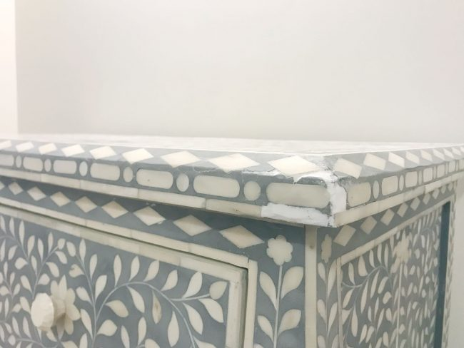 spackle fill to repair inlay tile that is missing or broken