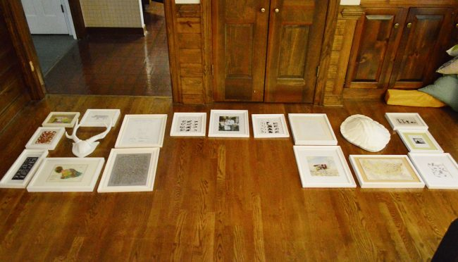 picture frames laid out on a floor in preparation for gallery wall