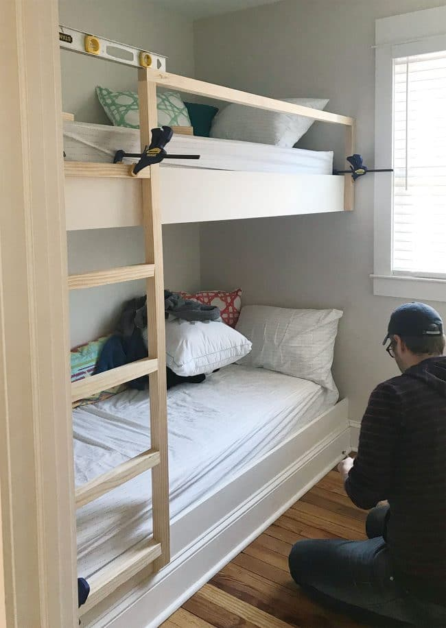 Advantages Of Utilizing Loft Beds For Kids Plans clamps holding diy bunk bed ladder and railings in place