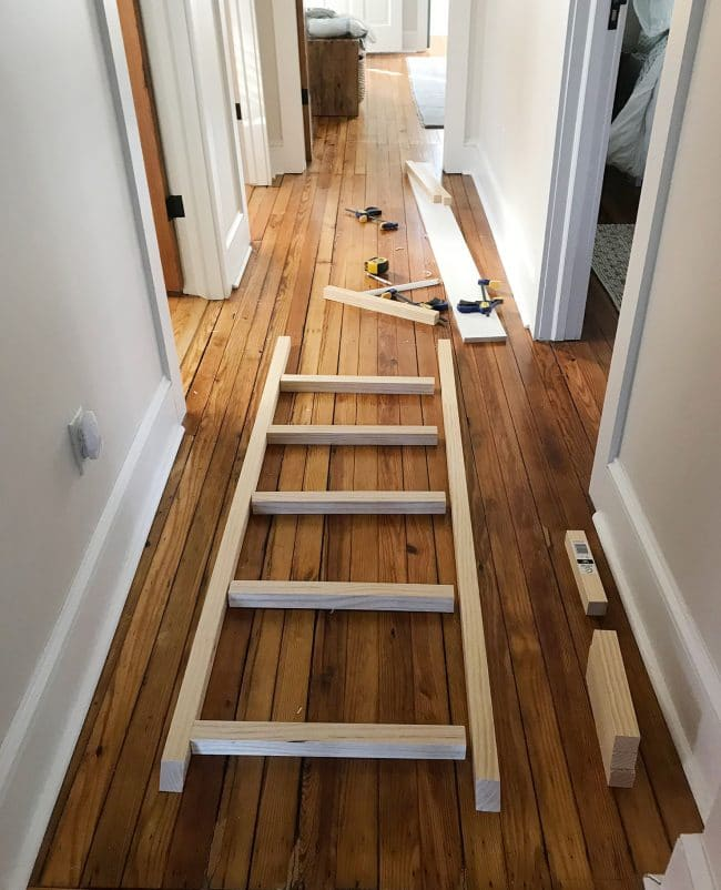 bunk bed ladder pieces laid out in hallway for construction