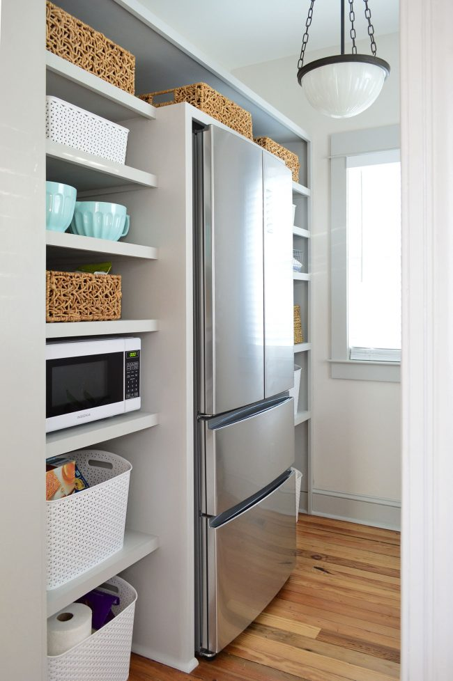 after photo of built in pantry shelving project painted gray with baskets on shelves