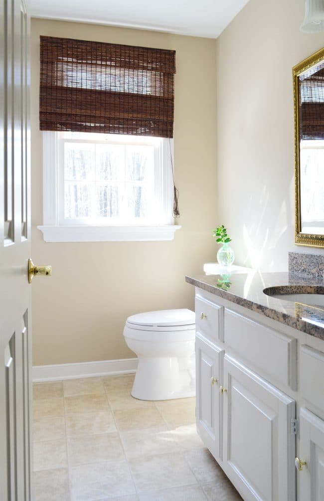 simple clean bathroom staged in house with no bathmat and clean counter