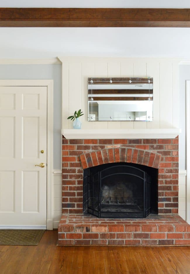 simple fireplace mantle with brick fireplace
