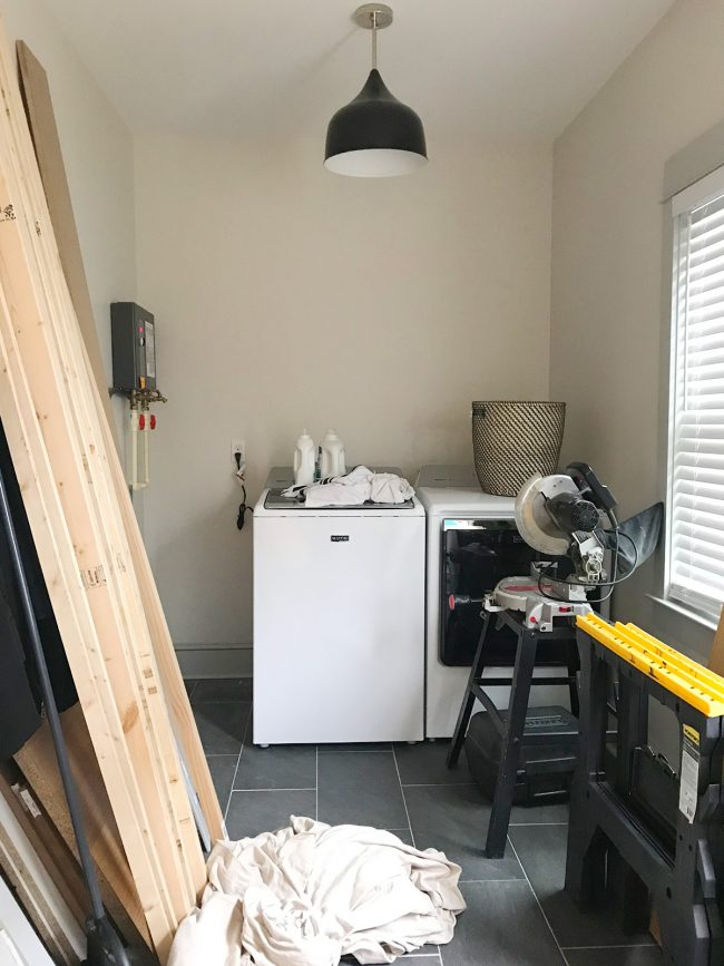 laundry room with appliances and tools