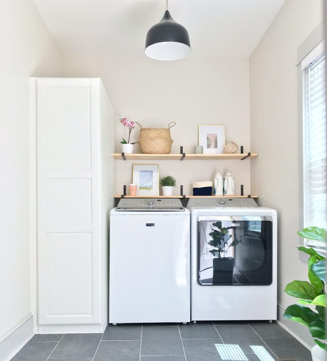 laundry room with top loading washer and ikea storage cabinet with floating shelves