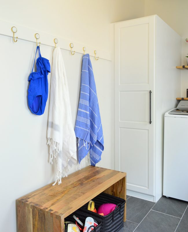 after photo of towels and bathing suit on hook rail in mudroom
