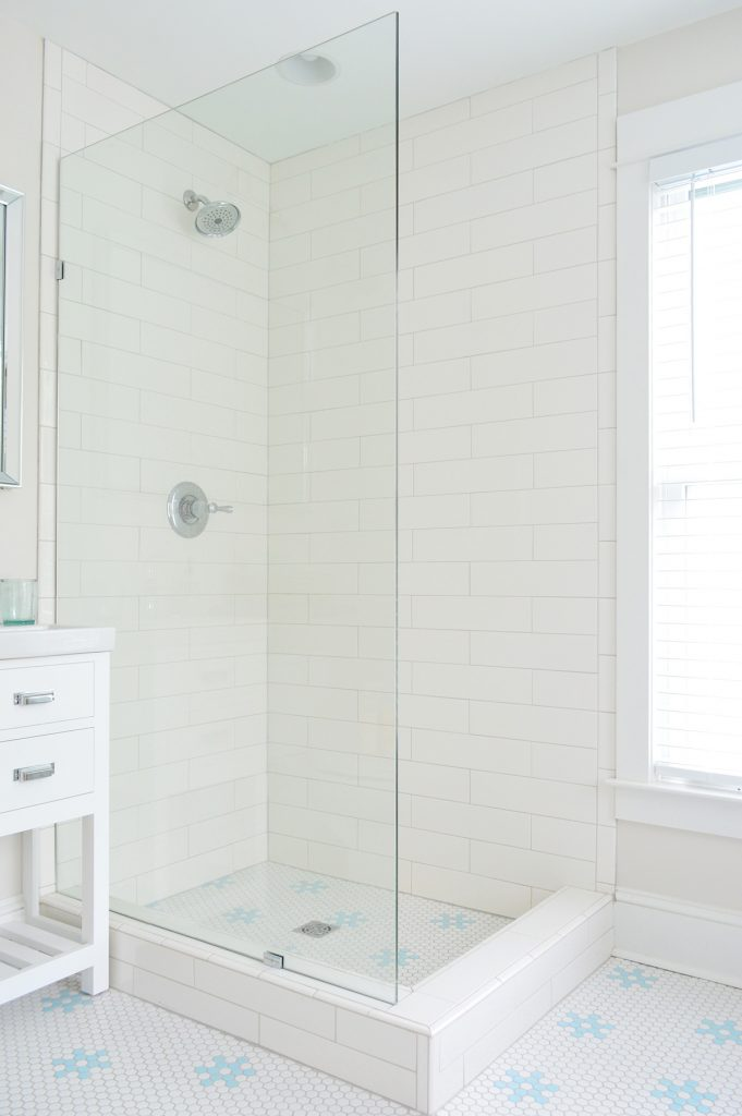 Frameless Glass Shower Panel In Subway Tile Bathroom