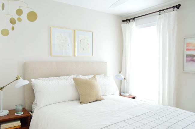 beach house guest bedroom with headboard in it