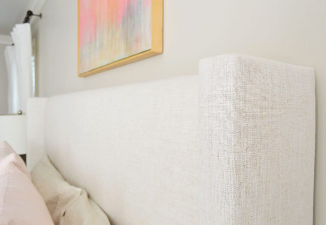 detail on upholstered bed with linen texture