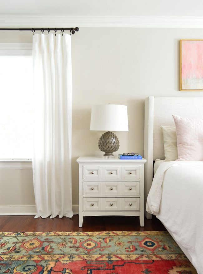 white ikea lenda curtain panels next to nightstand
