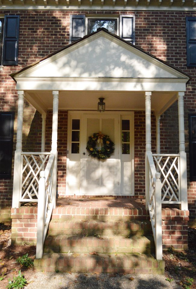 before of front porch of brick house with portico and railings