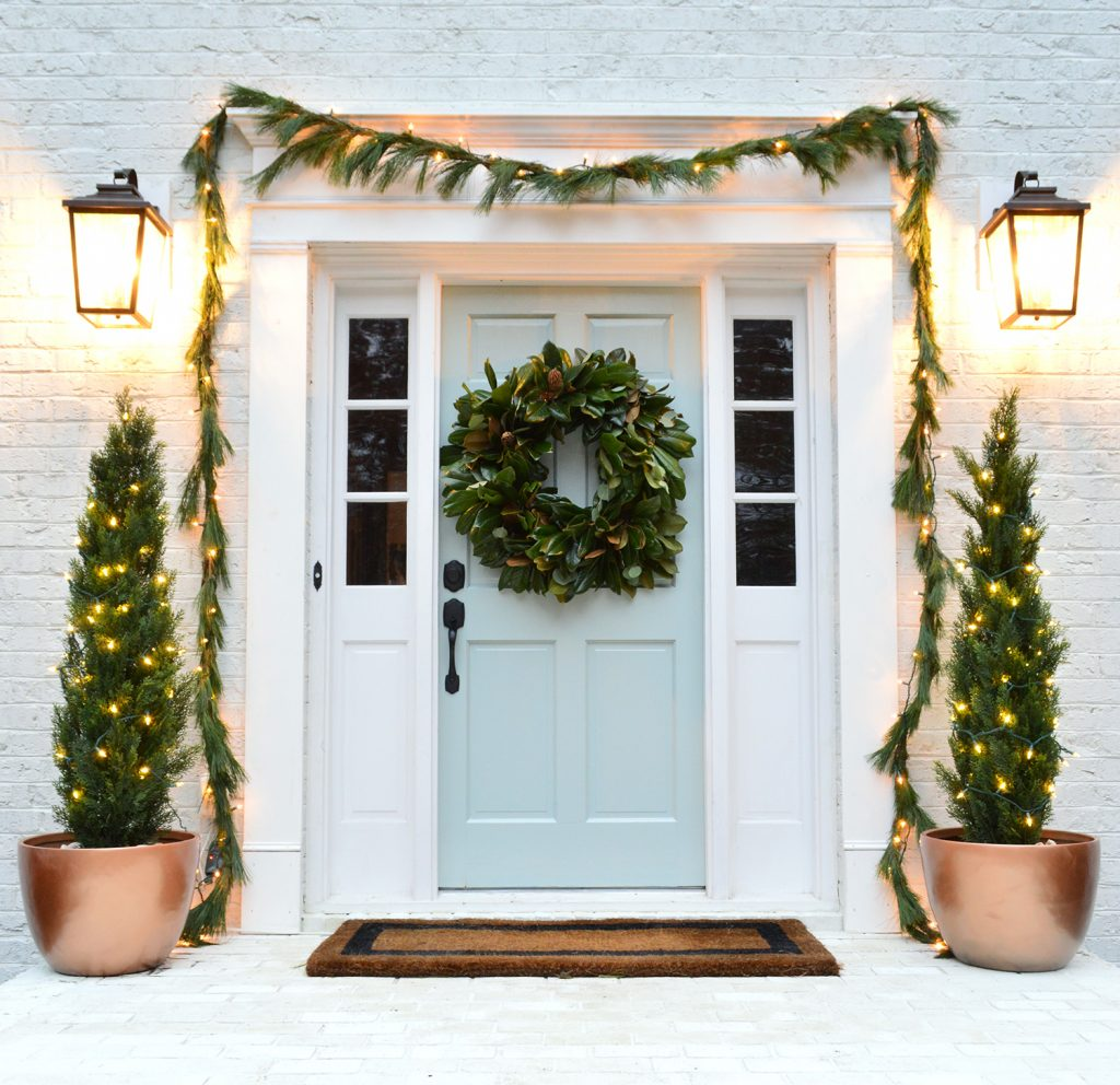 Glossy front door with christmas decorations tranquility benjamin moore
