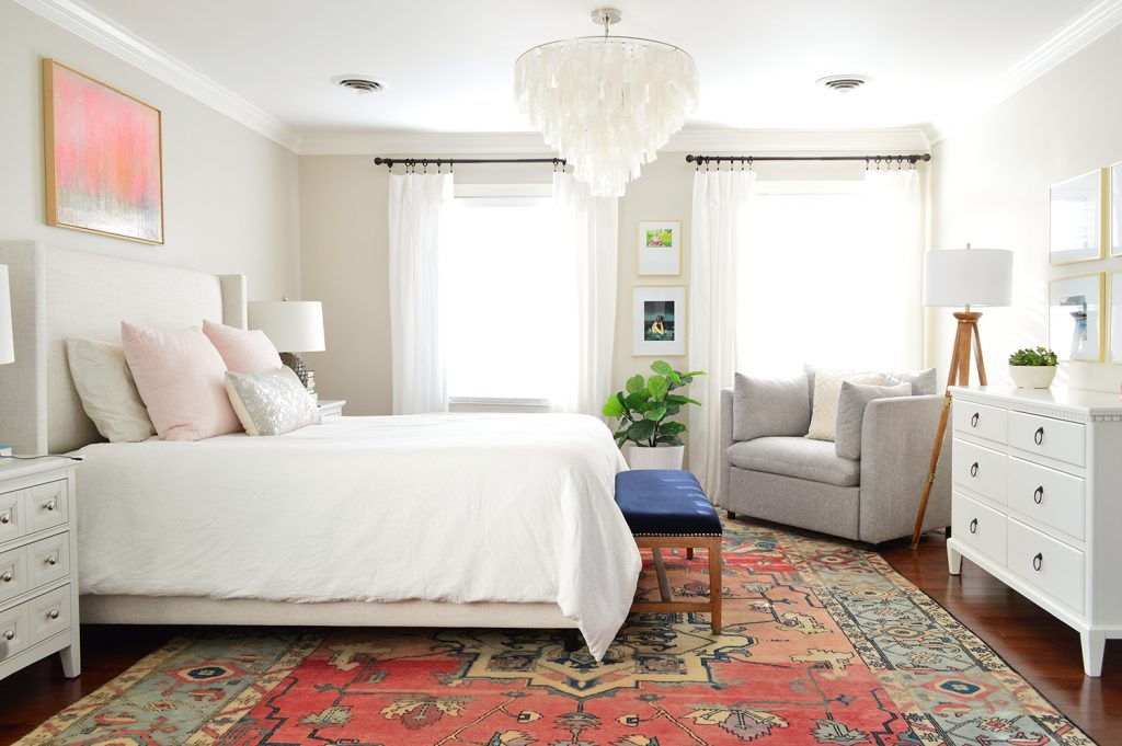 Neutral bedroom with capiz chandelier and faux fiddle leaf fig by window
