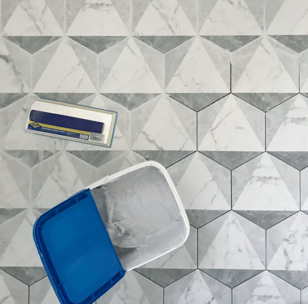 marble hex tiles getting grouted with mapei grout