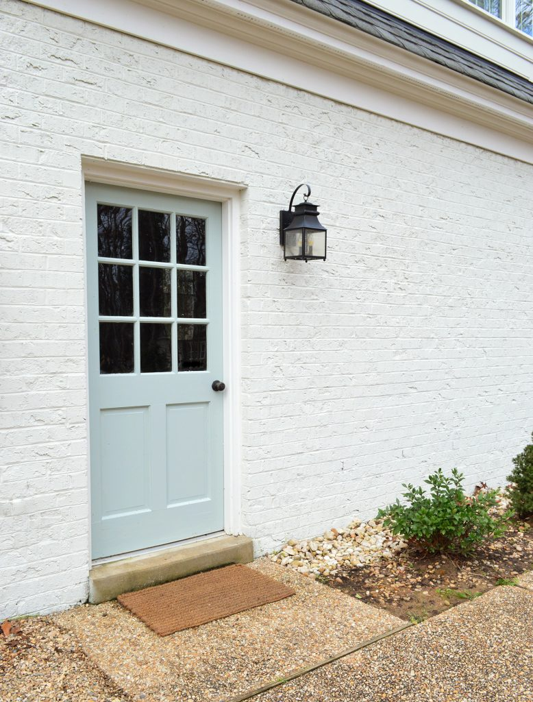 Back Door Painted Tranquility In High Gloss Against White Brick Garage
